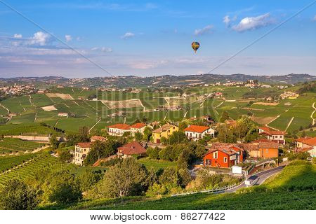 Small town among green hills and vineyards in Piedmont, Northern Italy.