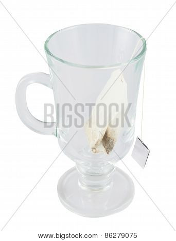 Glass teacup with a tea bag inside