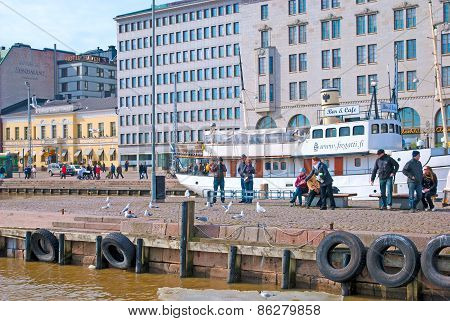 Helsinki. Finland. People feed seagulls
