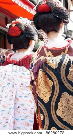 Kyoto, Japan - March 2015 - Geisha Wears Traditional Clothes With Signature White Powder On Neck