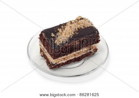 Biscuit Cake With Grated Nuts On Plate