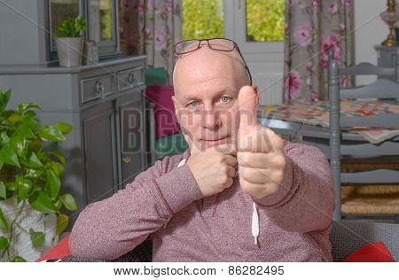 Man Shows His Thumb