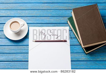 Pencil And Paper With Inscription Near Cup Of Coffee