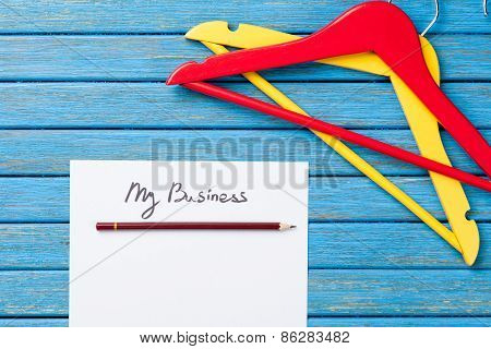 Paper With Inscription And Hangers