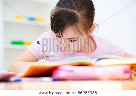Cute Girl Writes A Pen