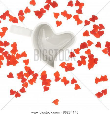 Heart shaped cup and confetti