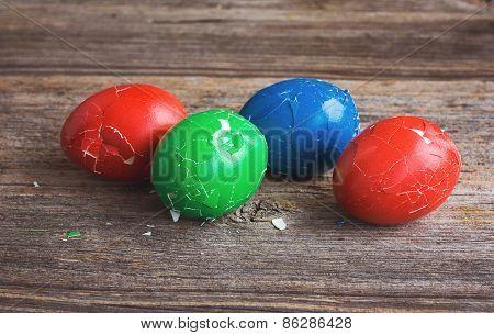Broken Easter Eggs On Wooden Background