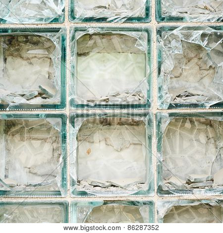 Old wall made of broken glass bricks