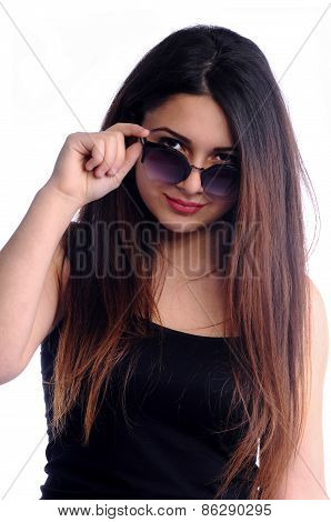 Pretty girl looking behind glasses