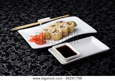 California Roll Sushi With Pickled Ginger, wasabi And Soy Sauce In The Plate