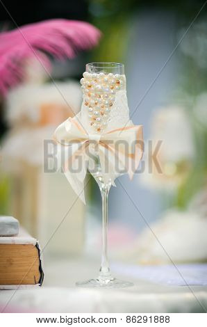 Decorated Wedding Glass With A .ribbon Bow