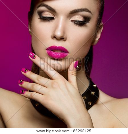 Beautiful Woman With Evening Make-up And Red Nails  Thorns.