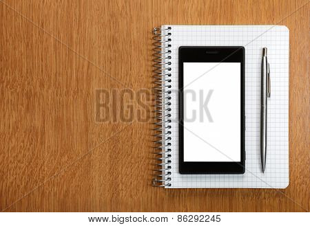 Business And Education Concept - Smartphone And Notepad