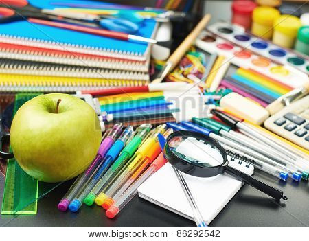 Desk covered with multiple stationery