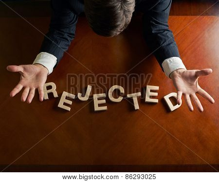 Word Rejected and devastated man composition