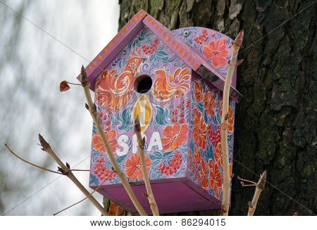 Decorated Birdhouse On The Trunk