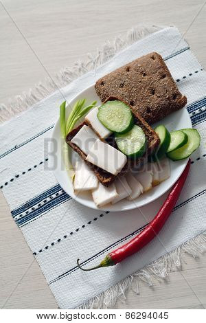 Lard And Cucumber Pieces On Rye Bread