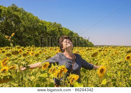 Woman With Hands Placed In Parties Among Sunflowers