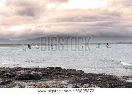 Wind Surfers Racing In The Storm