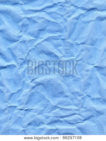 Wrinkled Blue Paper Fragment As A Background Texture