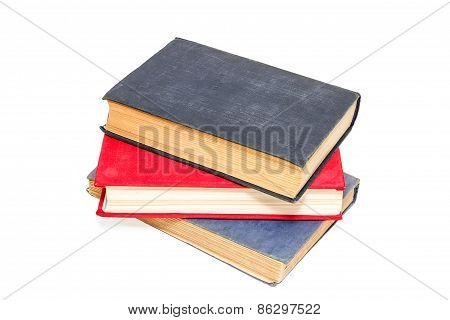 Three Old Books On A White Background