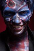 picture of bloody  - A creepy portrait of a halloween man with bloody body art and face art - JPG