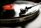 picture of view from space needle  - Close up view of old fashioned turntable playing a track from black vinyl - JPG