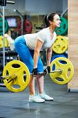 stock photo of heavy  - fitness woman doing exercises for back muscles with heavy weight - JPG