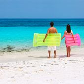 picture of raft  - Couple with inflatable rafts on a tropical beach at Maldives - JPG