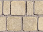 picture of paving stone  - light textured paving tiles imitating stone path with rounded edges and seams are covered with fine marble chips - JPG