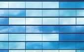 picture of framing a building  - Modern office building wall made of blue glass and steel frame background texture - JPG