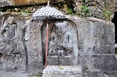 image of gunung  - Yeh Pulu is a famous carved cliff face dating back to the 15th century depicting daily scenes in Ubud - JPG