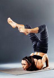 pic of scorpion  - Beautiful sporty woman is doing yoga asana - JPG