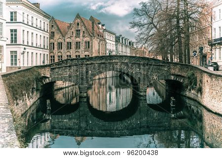 Scenic city view of Bruges canal and bridge