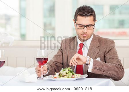 Cheerful young businessman has an appointment in restaurant
