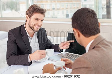 Handsome business partners are discussing a new project
