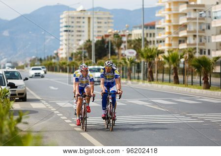Cyclists Riding Bicycle