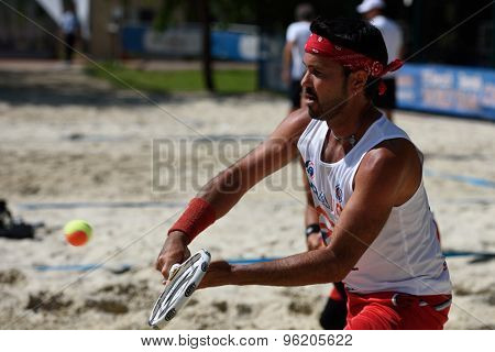 MOSCOW, RUSSIA - JULY 15, 2015: Patrice Bang of France in action during the ITF Beach Tennis World Team Championship. 28 nations compete in the event this year