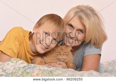 Boy with grandmother and cat