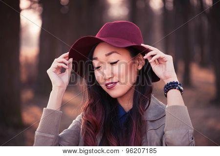 Asian woman in hat