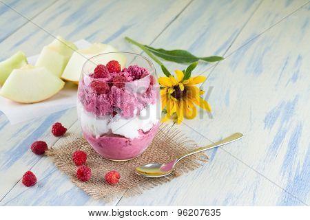 Glass Cup Of Fruit Ice Cream On Burlap