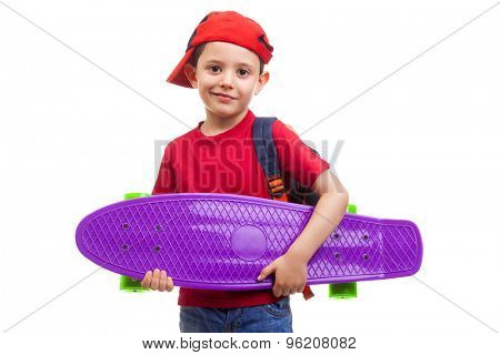 Schoolkid standing with skateboard and backpack on white background