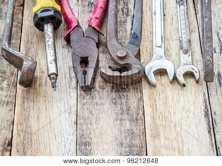 Close Up Bunch Of Used Tools On Wooden Background