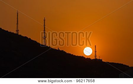 Sun over the hill
