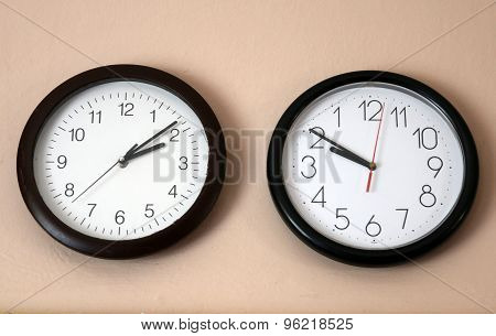 Two Clock One In Reverse