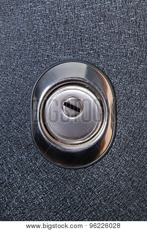 Close up of keyhole in round lock, safety concept. Door element