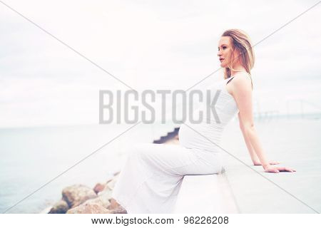 Healthy Pregnant Woman Relaxing At The Seaside