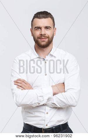 Solid man with crossed arms isolated background