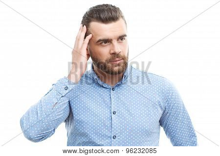 Man touching his head with hand