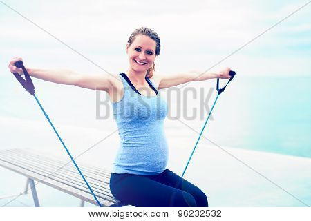 Pregnant Woman Exercising With Ropes